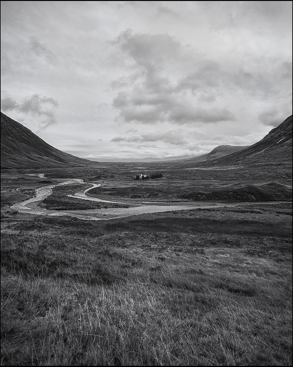 little house in the middle of a vast landscape near glencoe black and white photograph