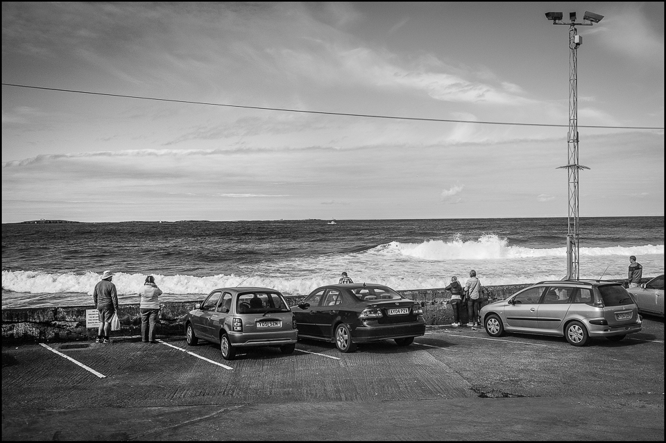 black and white of the sea from the parking lot at Seahouses in Northumberland UK